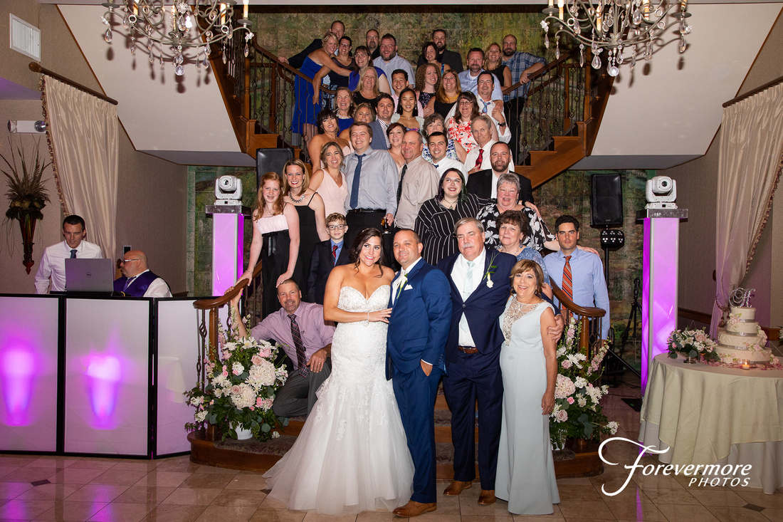Large family group shot on the stairs of Talamore Country Club